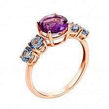 Кольцо в красном золоте Королева с аметистом и голубыми топазами