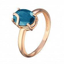 Кольцо из красного золота Жанин с синтезированным синим топазом