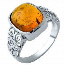 Серебряное кольцо Дебора с завальцованным янтарем и узорными элементами на шинке