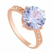 Золотое кольцо с голубым топазом и фианитами Эстель