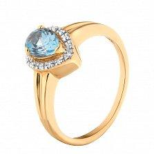 Золотое кольцо Капля вечности в красном цвете с голубым топазом и фианитами