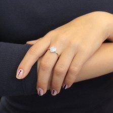 Золотое кольцо Сердечко в красном цвете в усыпке фианитов