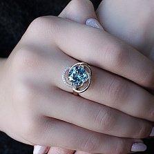 Кольцо в красном золоте Кристина с голубым топазом и фианитами