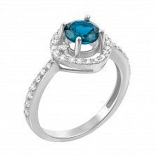Кольцо из белого золота с голубым топазом и фианитами 000131275