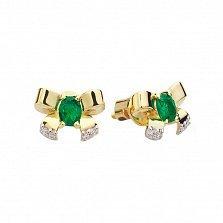 Золотые пуссеты с изумрудами и бриллиантами Бантики