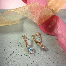 Золотые серьги-подвески Инесса с голубым топазом и цирконием