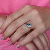 Золотое кольцо Кушон с голубым топазом