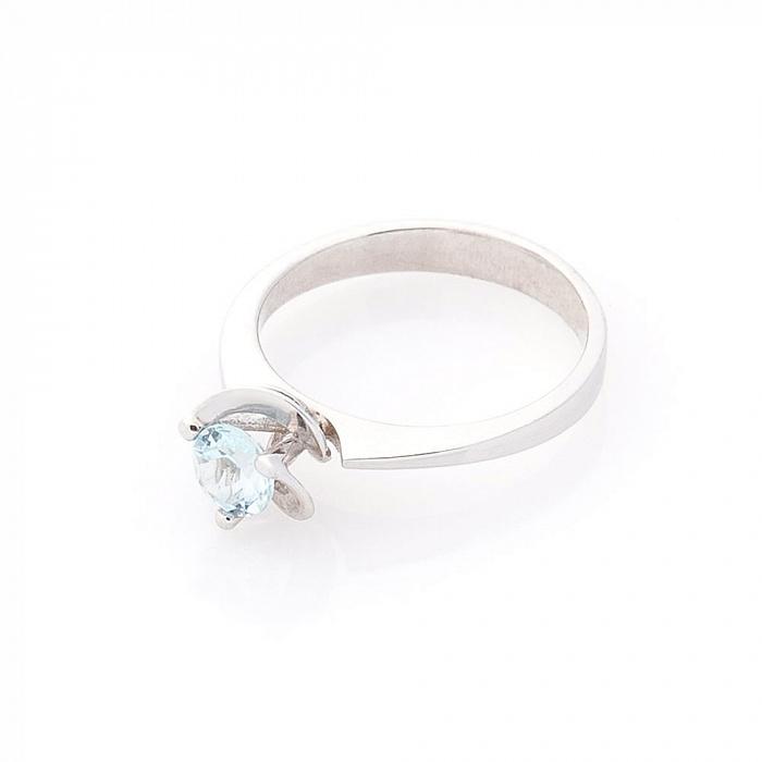 Золотое родированное кольцо Дикая роза в белом цвете с голубым топазом 000082288