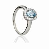 Серебряное кольцо с голубым топазом и цирконием Ингрид