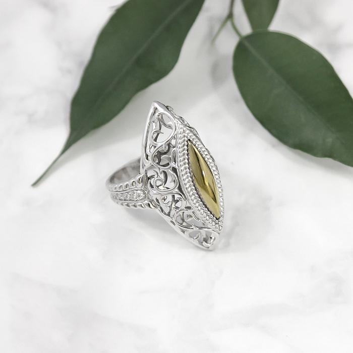 Серебряное кольцо с золотой вставкой и фианитами Рубина 000030061