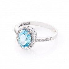 Золотое кольцо Филис с узорным кастом, голубым топазом и дорожками белых фианитов