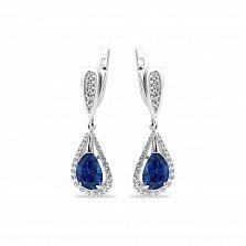 Серебряные родированные серьги-подвески Полианна с синими алпанитами и белыми фианитами