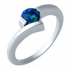 Серебряное родированное кольцо Дания с синим опалом