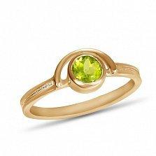 Золотое кольцо Сатурн с завальцованным хризолитом