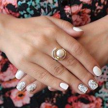 Серебряное кольцо Орбита с белым жемчугом и золотой накладкой