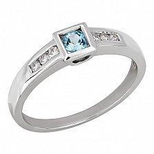 Золотое кольцо Раут с голубым топазом и бриллиантом