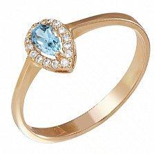 Золотое кольцо Капля росы с голубым топазом и фианитами