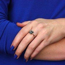 Кольцо в красном золоте Ингрид с голубым топазом