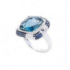 Золотое кольцо Королева зимы в белом цвете с лондон топазом, сапфирами и бриллиантами