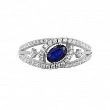 Серебряное кольцо Бертранита с шинкой фантазийной формы, сапфиром и дорожками фианитов