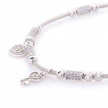 Браслет из белого золота Ключик и замочек-сердечко с кристаллами циркония