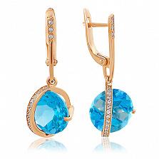 Золотые серьги Модерн с голубым топазом и фианитами