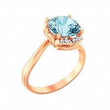 Золотое кольцо Дакей с голубым топазом и фианитами