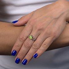 Серебряное кольцо Импреза с синтезированным хризолитом и фианитами
