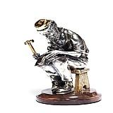 Серебряная статуэтка с позолотой Башмачник