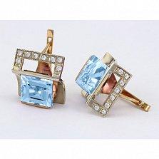 Золотые серьги с голубым топазом и фианитами Эпатаж