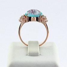 Золотое кольцо с топазом и фианитами Дэриа