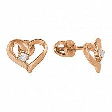 Позолоченные серебряные сережки-пуссеты Свет твоего сердца с фианитами