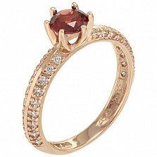 Золотое кольцо Жанна с гранатом и фианитами