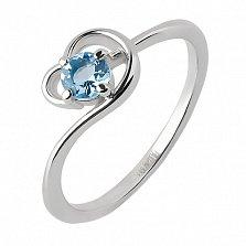 Кольцо из белого золота Песня реки с голубым топазом и цирконием