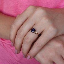 Золотое кольцо Кушон с сапфировым корундом