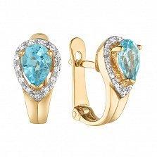 Золотые серьги Капля вечности в красном цвете с голубыми топазами и фианитами