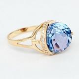 Золотое кольцо с топазом и фианитами Илэрия