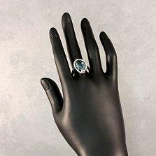 Серебряное кольцо Рихарт с синтезированным кварцем синего цвета и белыми фианитами