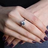 Серебряное кольцо с голубым топазом и фианитами Забвение