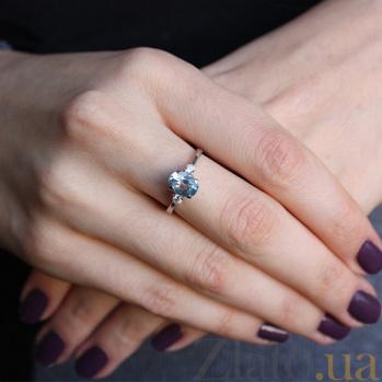 Серебряное кольцо с голубым топазом и фианитами Забвение 000032439