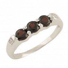 Серебряное кольцо Ксантия с гранатом и фианитами