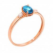 Золотое кольцо в красном цвете с топазом