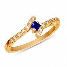 Золотое кольцо Анталия в красном цвете с синтезированным сапфиром и дорожками фианитов
