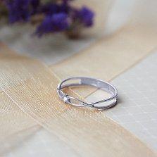 Золотое кольцо Бесконечное переплетение в белом цвете с бриллиантом