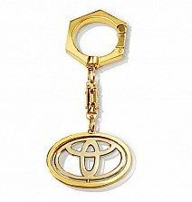 Золотой брелок Toyota с вращающимся логотипом