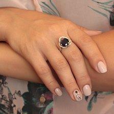 Серебряное кольцо Дианора с синтезированным сапфиром и фианитами
