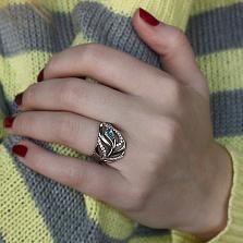 Серебряное кольцо Волшебное перышко с голубым и белыми фианитами