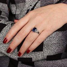 Серебряное кольцо Суарра с гидротермальным сапфиром и фианитами