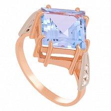 Золотое кольцо с голубым топазом и фианитами Афият