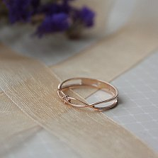 Золотое кольцо Бесконечное переплетение с бриллиантом